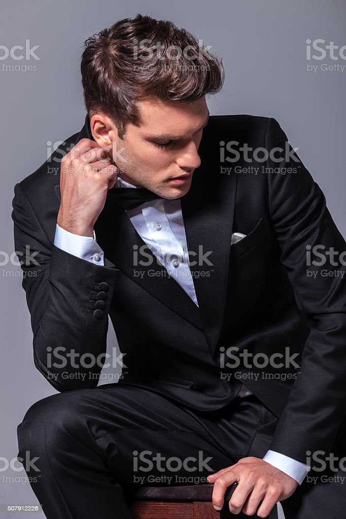 Elegant business man sitting on a chair while stock photo