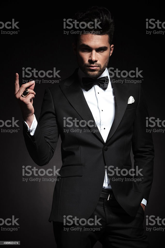 elegant business man snapping his fingers stock photo