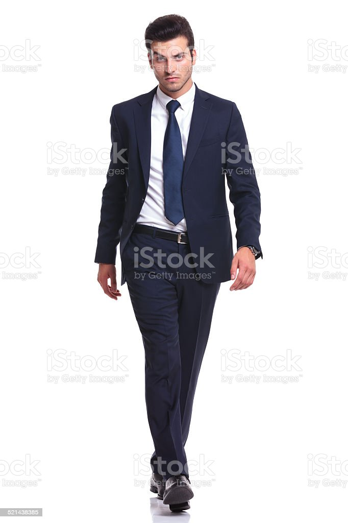 elegant business man walking on white background stock photo