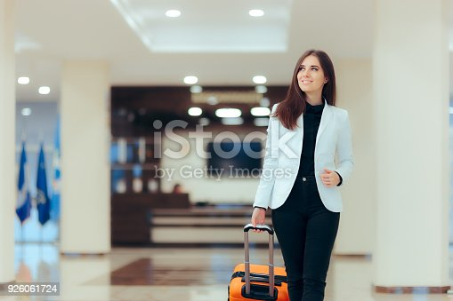istock Elegant Business Woman with Travel Trolley Luggage in Hotel Lobby 926061724