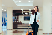 Female executive with suitcase in work related business trip