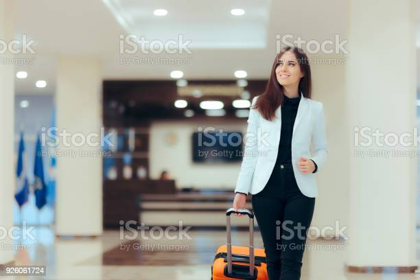 Elegant business woman with travel trolley luggage in hotel lobby picture id926061724?b=1&k=6&m=926061724&s=612x612&h=qmjf4uok9y7eaa 5rnh mqozvgky1m6 okqspxpffv4=