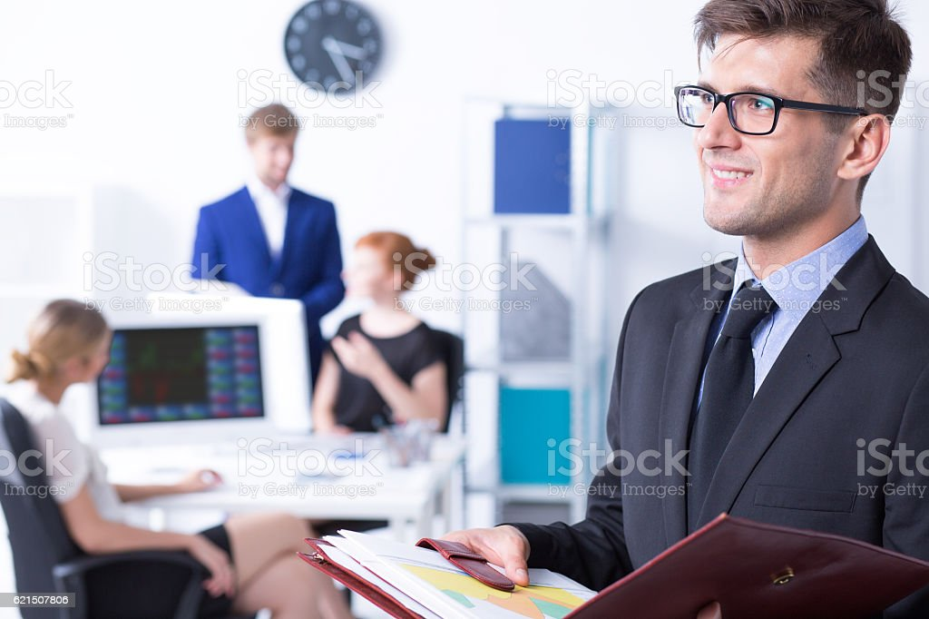Elegant businessman and his employees foto stock royalty-free
