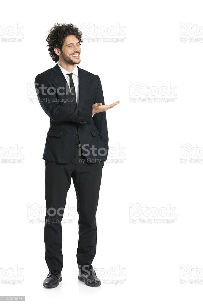 Elegant Businessman Giving Presentation stock photo