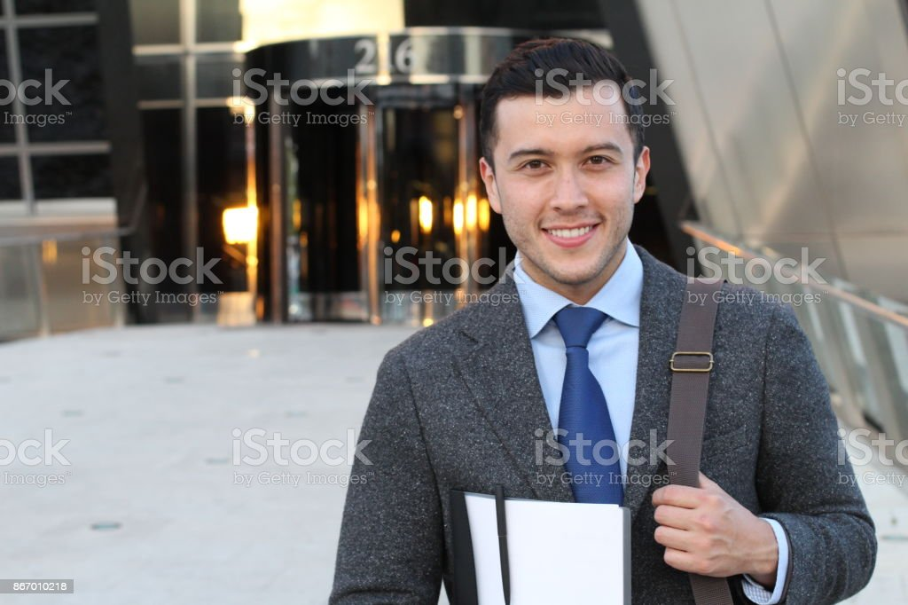 Elegant businessman outside the office with copyspace stock photo