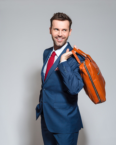 Elegant Businessman Wearing Suit Holding Briefcase Stock Photo - Download Image Now