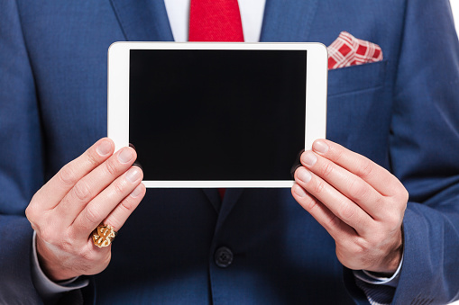 Elegant Businessman Wearing Suit Holding Digital Tablet Stock Photo - Download Image Now