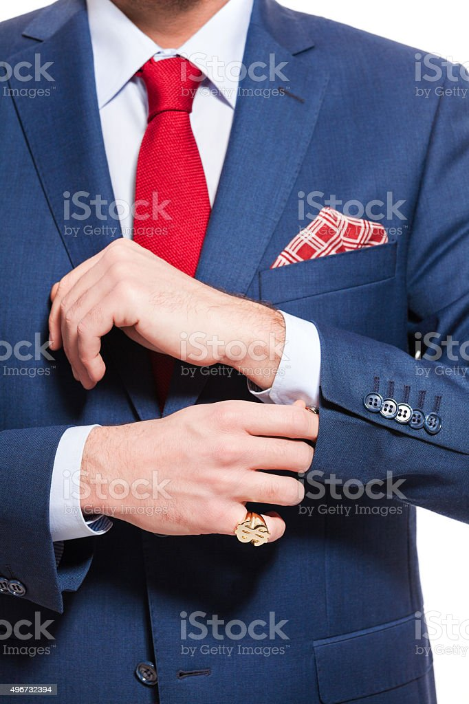 Elegant businessman wearing suit Portrait of elegant businessman wearing suit. Standing against white background. Studio shot, unrecognizable person. Close up of torso and hands. 2015 Stock Photo