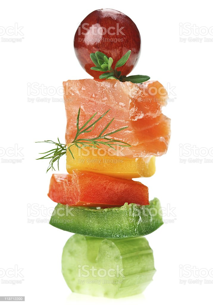 Elegant canape with salmon, celery, dill twig and grape royalty-free stock photo