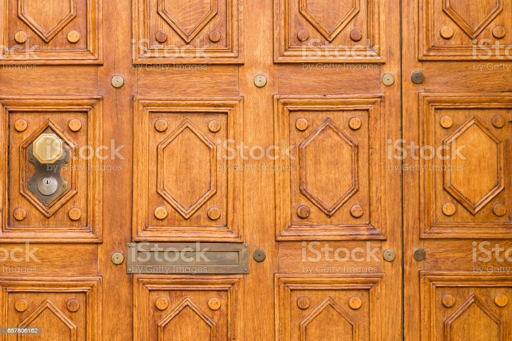 Elegant carved brown wooden door stock photo
