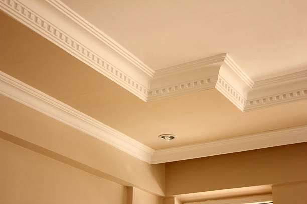 elegant ceiling with tan and cream paint colors - crown stock photos and pictures