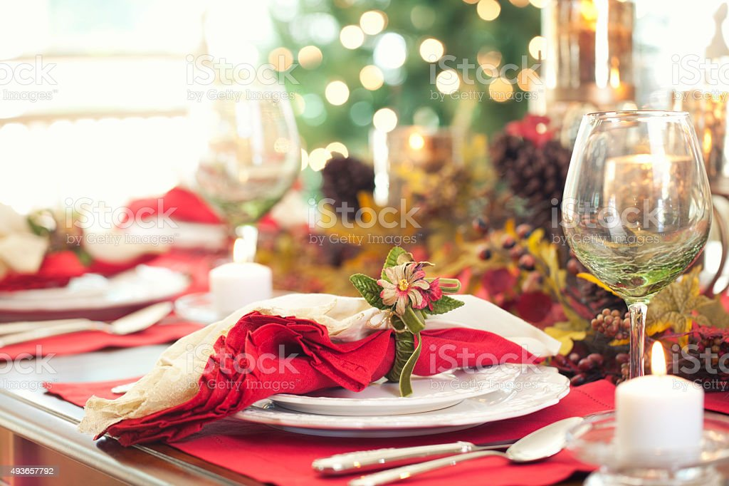 Elegant Thanksgiving holiday dining in front of Christmas Tree