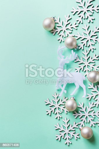 istock Elegant Christmas New Year Greeting Card Poster White Reindeer Snow Flakes Ball on Light Turquoise Blue Background. Copy Space. Scandinavian Style. Creative Design 860571406