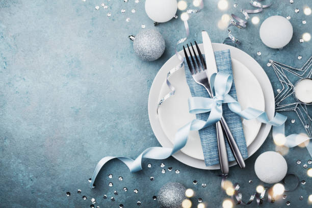 elegant christmas table setting for holiday dinner top view. bokeh effect. - blue table setting stock photos and pictures