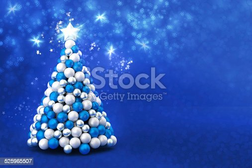 Happy and elegant Christmas tree entirely made of blue, white and metal shiny balls with a glowing star on top, with blue background decorated by snow flakes and night stars. Card decoration with copy space on image side.