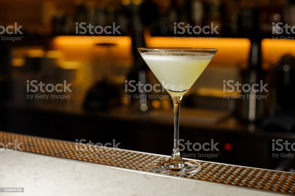 Elegant cocktail glass filled with a fresh alcoholic drink stock photo