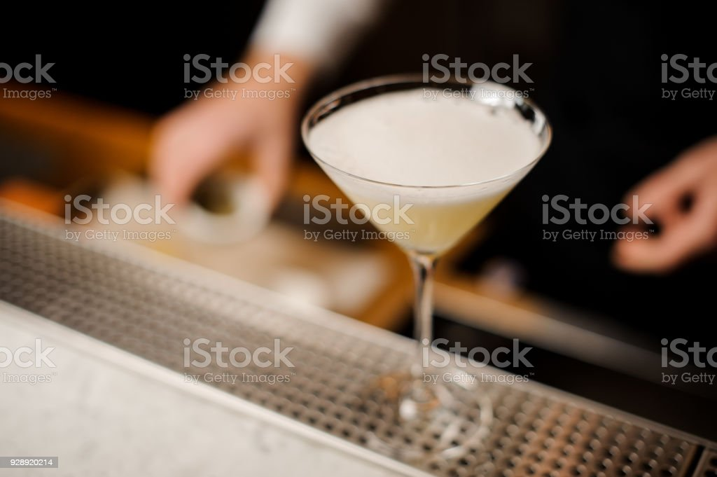 Elegant cocktail glass filled with fresh alcoholic drink stock photo