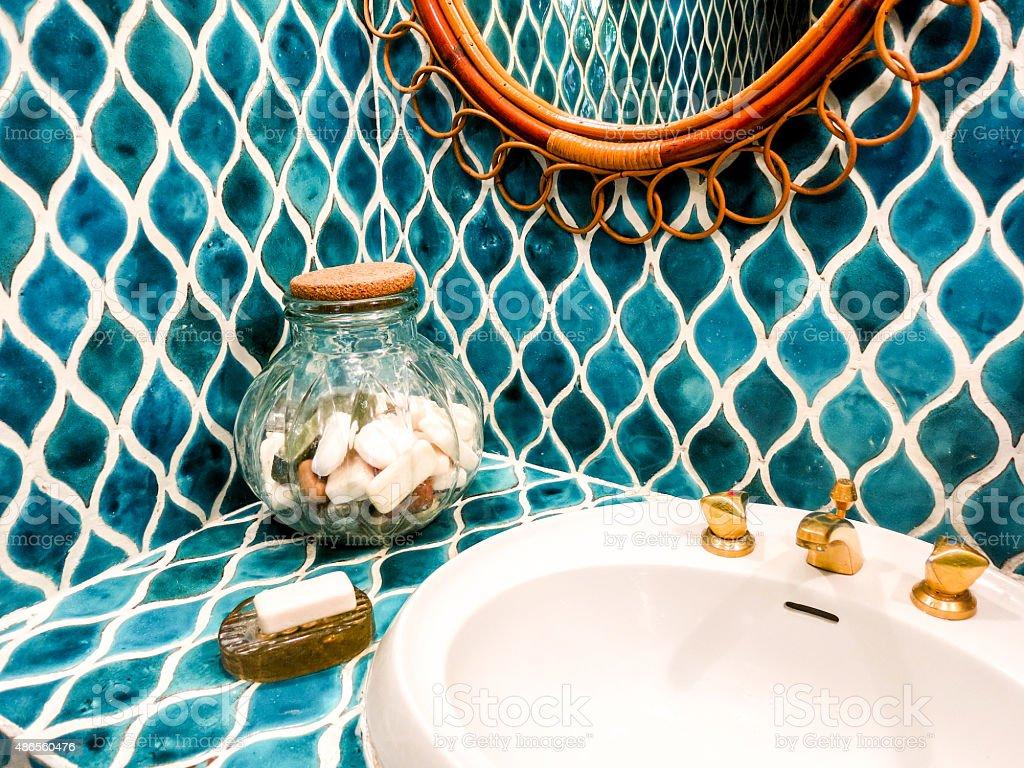 Elegant colorful blue tiled bathroom sink stock photo