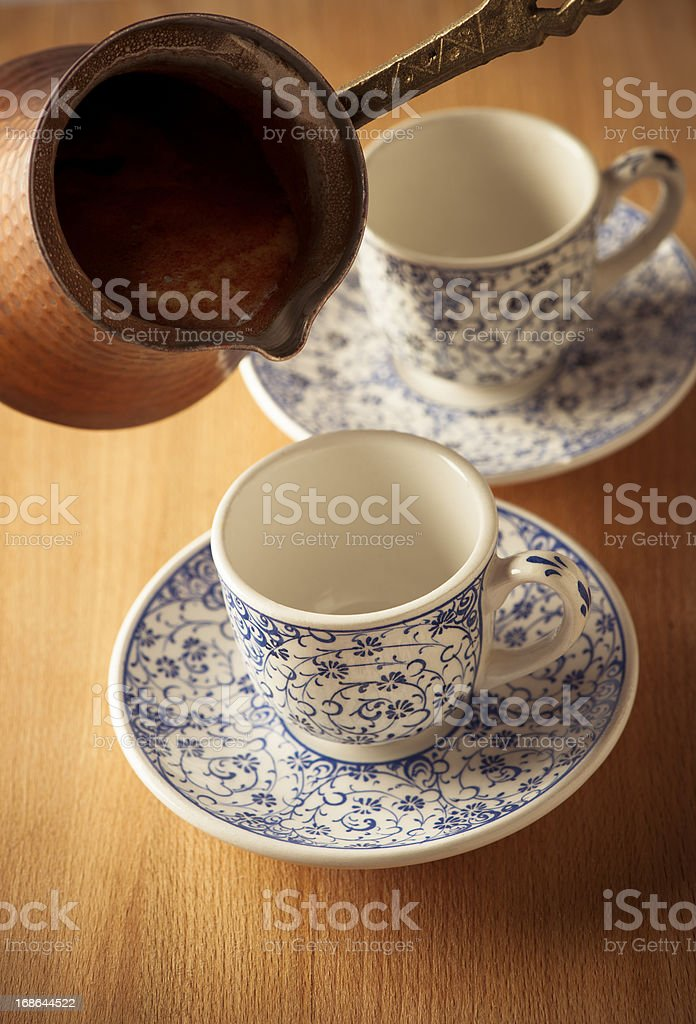 Elegant Copper Coffee Pot and  Cup royalty-free stock photo