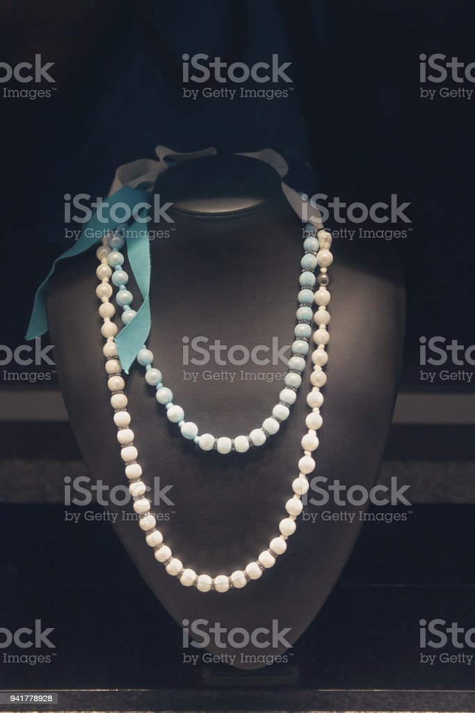 Elegant costume jewelry in the shop window. Sales