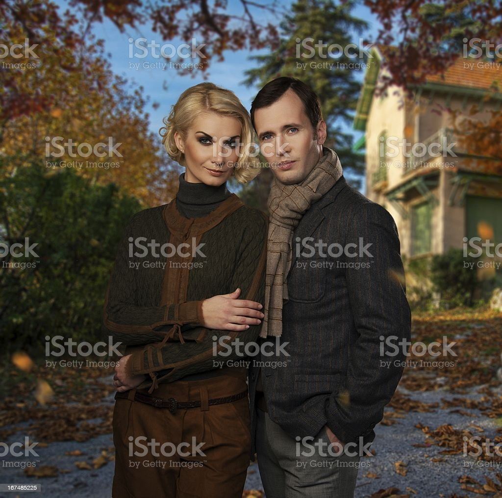 Elegant couple against country house on autumn day royalty-free stock photo