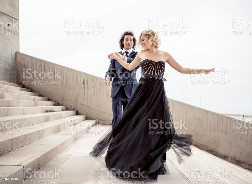 Elegant couple dancing together stock photo