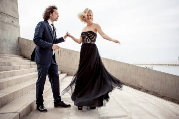 elegant couple dancing together - prom fashion stock photos and pictures
