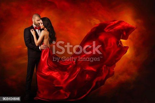 istock Elegant Couple, Dancing Woman in Red Dress Fluttering Wind, Love Beauty Portrait, Man in Black Suit 903404646