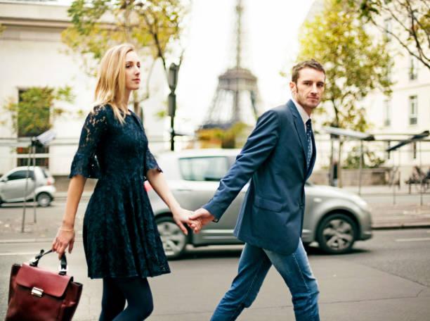 elegant couple in paris - paris fashion stock photos and pictures