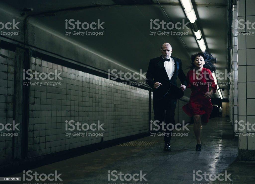 elegant couple running stock photo