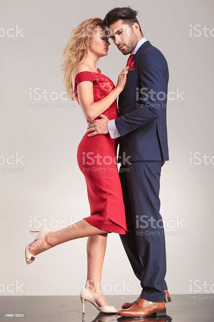 Elegant couple standing face to face stock photo