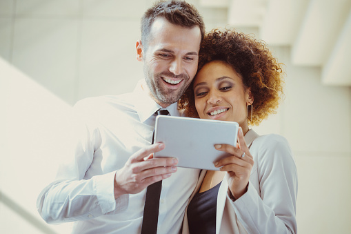 Elegant Couple Using A Digital Tablet Together Stock Photo - Download Image Now