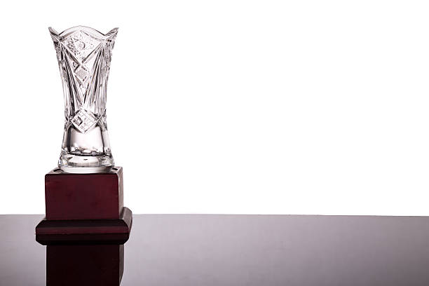 Elegant crystal vase trophy on white background flushed left stock photo