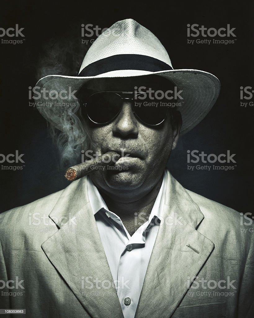 elegant cuban mysterious man smoking a cigar stock photo