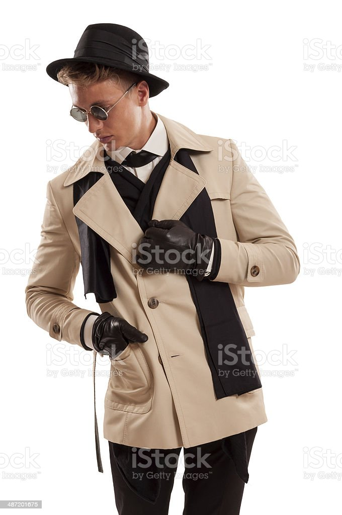 Elegant detective posing on a white background royalty-free stock photo