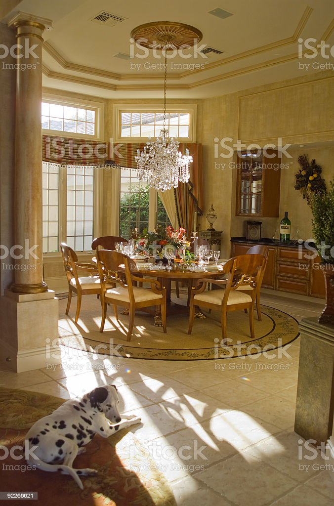 Elegant Dining Room With Sun Coming in Windows Wide Angle stock photo