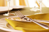 Close-up shot of elegant dinner table setting with shallow depth of field.
