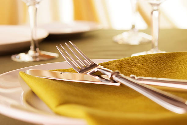 elegant dinner table setting with shallow depth of field - arranging stock photos and pictures