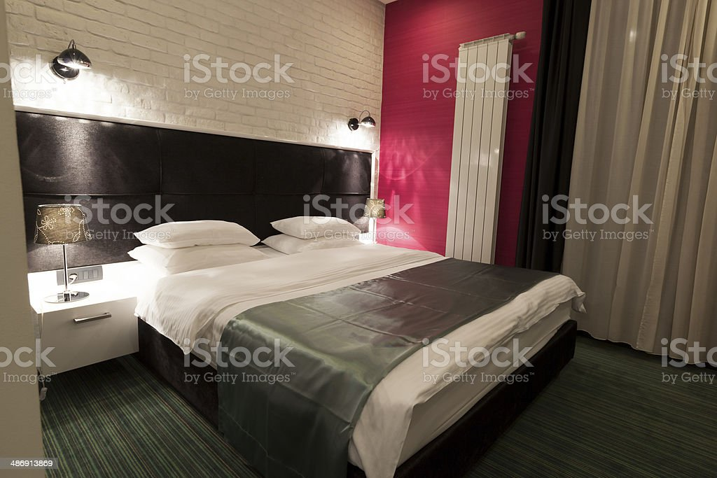Elegant double bed hotel room royalty-free stock photo