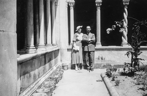 Elegant dressed couple having fun visiting Rome for their wedding in the 1930s. Italy.
