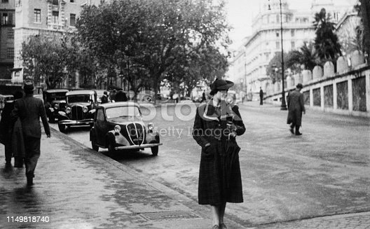 Elegant dressed lady having fun visiting Rome in the 1936.Italy.