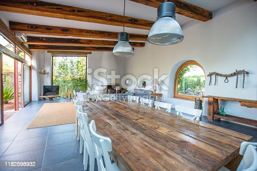 istock Elegant farmhouse dining room, living room in Barcelona 1182598932
