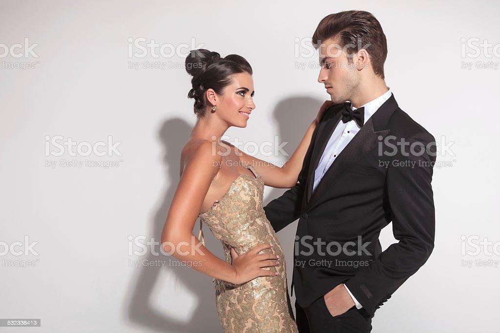 Elegant fashion couple embracing stock photo