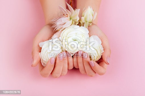 istock Elegant female hands with Pink Manicured Nails. 1084552676