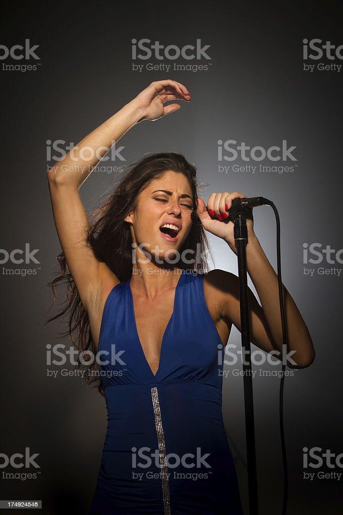 Elegant female vocalist royalty-free stock photo