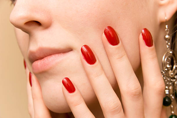 Elegant fingers on woman face stock photo
