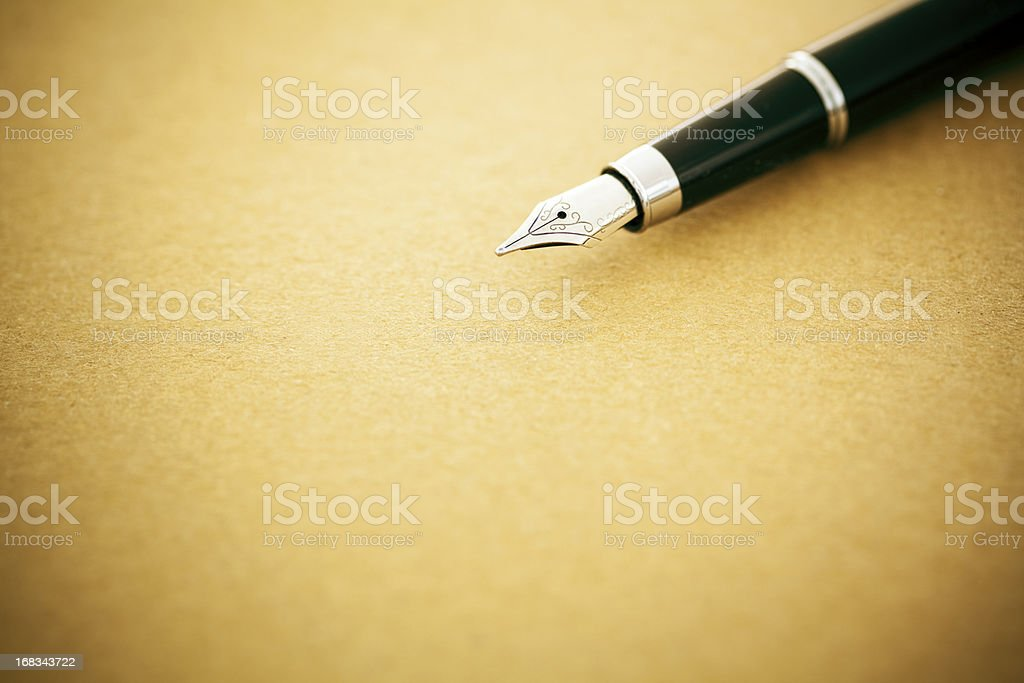 Elegant fountain pen on old empty paper stock photo