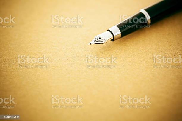 Elegant Fountain Pen On Old Empty Paper Stock Photo - Download Image Now