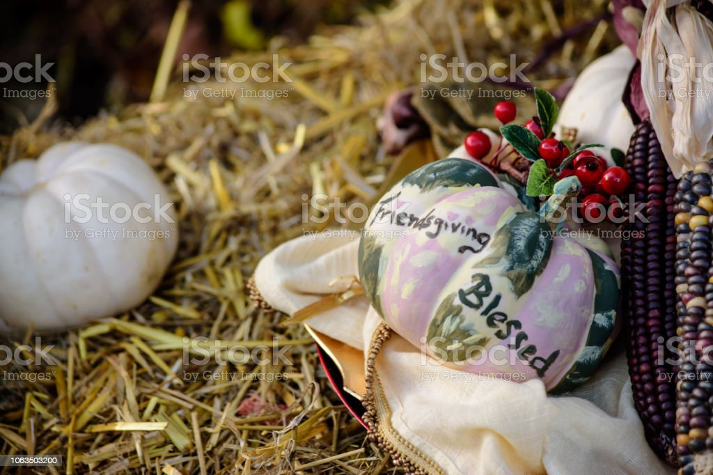 Elegant Friendsgiving rustic background with Thanksgiving centerpiece on hay stock photo