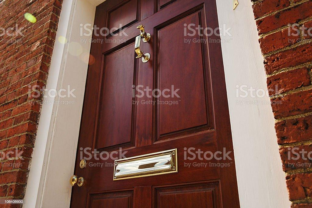 Elegant Front Door in a Brick Building royalty-free stock photo